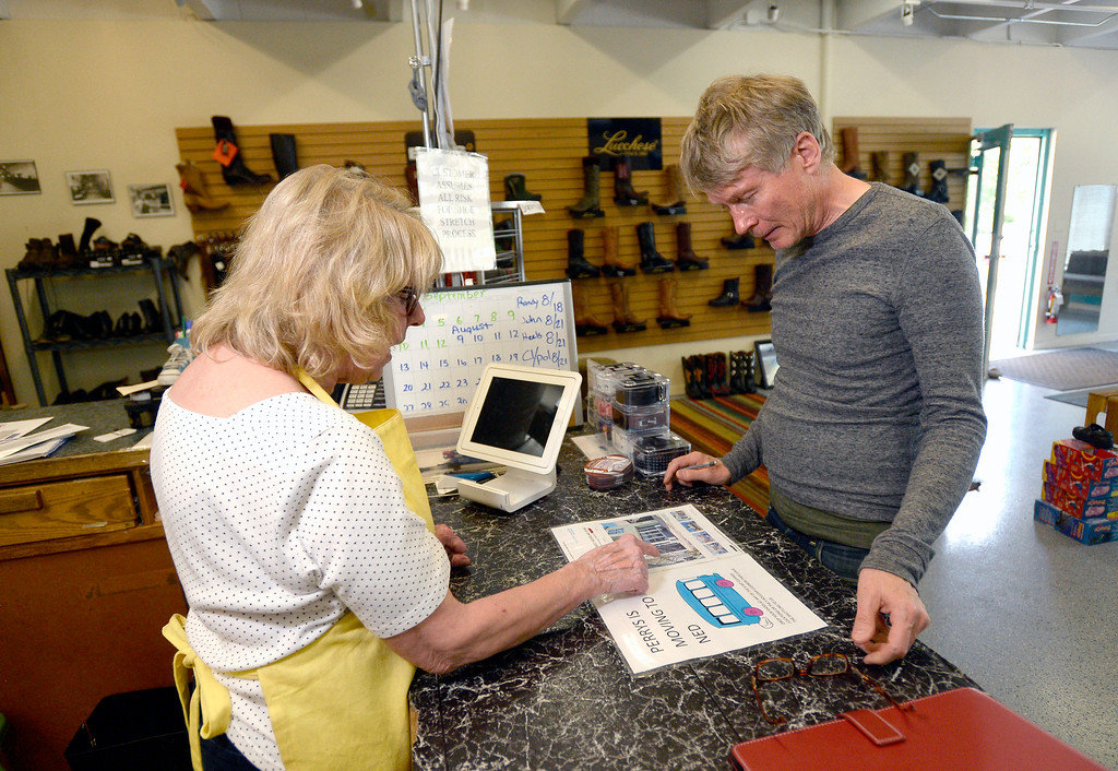 . Co-owner Becky Perry, at left, tells Eirikur Baldursson about the shops upcoming move to Nederland at Perry\'s Shoe Shop on Friday in Boulder. For more photos of the shoe shop go to dailycamera.com Jeremy Papasso Staff Photographer Aug. 11, 2017