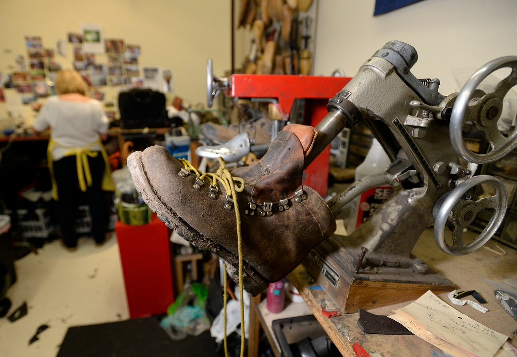 . A boot waits to be fixed at Perry\'s Shoe Shop on Friday in Boulder. For more photos of the shoe shop go to dailycamera.com Jeremy Papasso Staff Photographer Aug. 11, 2017