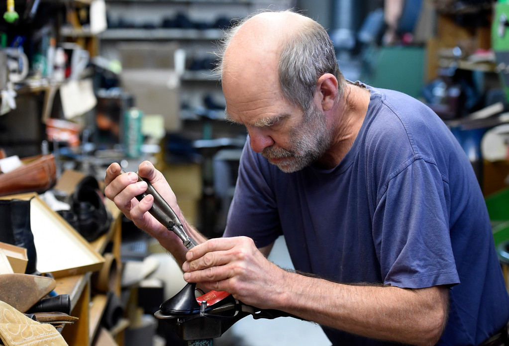 . Co-owner George Perry fixes the heel of a pair of shoes at Perry\'s Shoe Shop on Friday in Boulder. For more photos of the shoe shop go to dailycamera.com Jeremy Papasso Staff Photographer Aug. 11, 2017