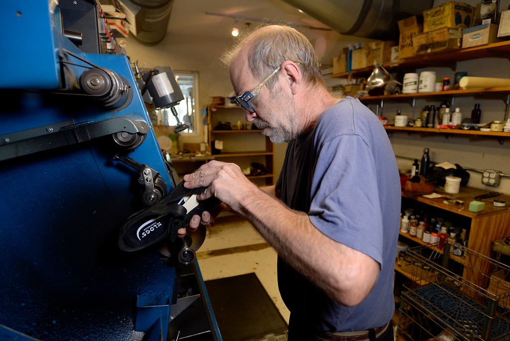 . Co-owner George Perry works to fix a pair of shoes for a customer at Perry\'s Shoe Shop on Friday in Boulder. For more photos of the shoe shop go to dailycamera.com Jeremy Papasso Staff Photographer Aug. 11, 2017