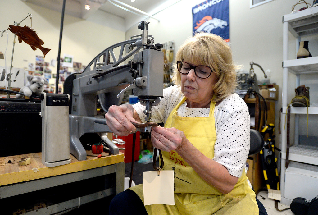 . Co-owner Becky Perry fixes a dog leash on a sewing machine at Perry\'s Shoe Shop on Friday in Boulder. For more photos of the shoe shop go to dailycamera.com Jeremy Papasso Staff Photographer Aug. 11, 2017