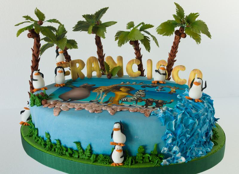 Madagascar, palmeras, pingüinos, letras en azúcar.