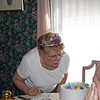 Grandma blowing out candles on her birthday cake