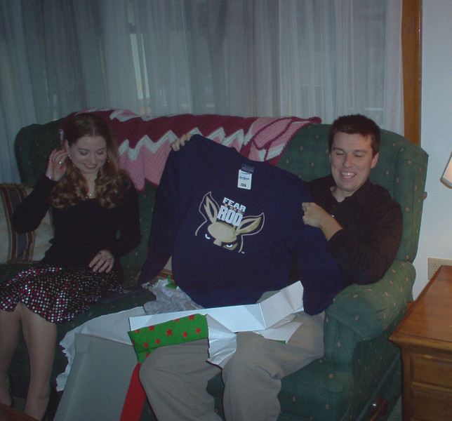 John opening his present from mom.