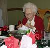 Grandma opening a present.