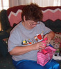 Mom opening a gift from Vickie's