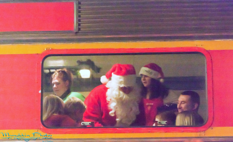 Santa on the train handing out the bells.