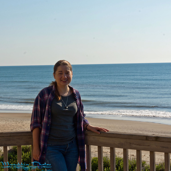 me on the deck of the beach house