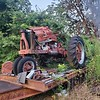 M Farmal Tractor / 3 pt hyd hitch on back / engine needs work. And 3 axle back hoe trailer. / $2500 for both or make offer. (Separately, the tractor is $1,000 and trailer $1,500)