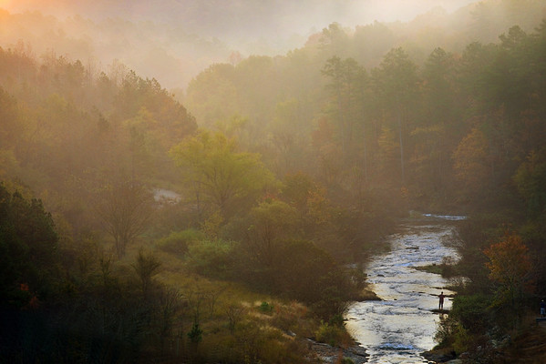 Early morning at Beaver's Bend in Southeastern Oklahoma. Lots of fog in the mornings if it's cool enough, and the sun coming up over the hills and spilling into the valleys make for some very dramatic scenes.