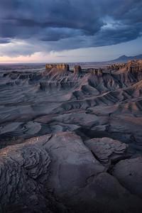 Pre-morning light glows across Utah's southern badlands