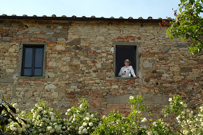 Bernd checking out the view (glass of wine in hand), from our bedroom window