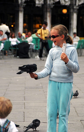 Feeding the pigeons is a favourite pastime in the square