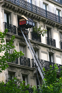 This is how they move furniture and goods in and out of apartments.  Most buildings are 4 or 5 stories high, and either don't have an elevator, it's a teeny-tiny capsule, that barely holds a person, let alone furniture.