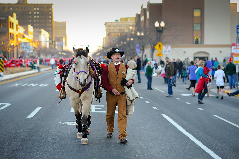 Ron Gardener and his Horse named Sundance Walking down the street to get in position for the Parade in Ogden On November 24, 2012 (Brian Wolfer Special to the STANDARD-EXAMINER)