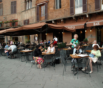 Pat & I enjoying some gelato in the town square at Siena