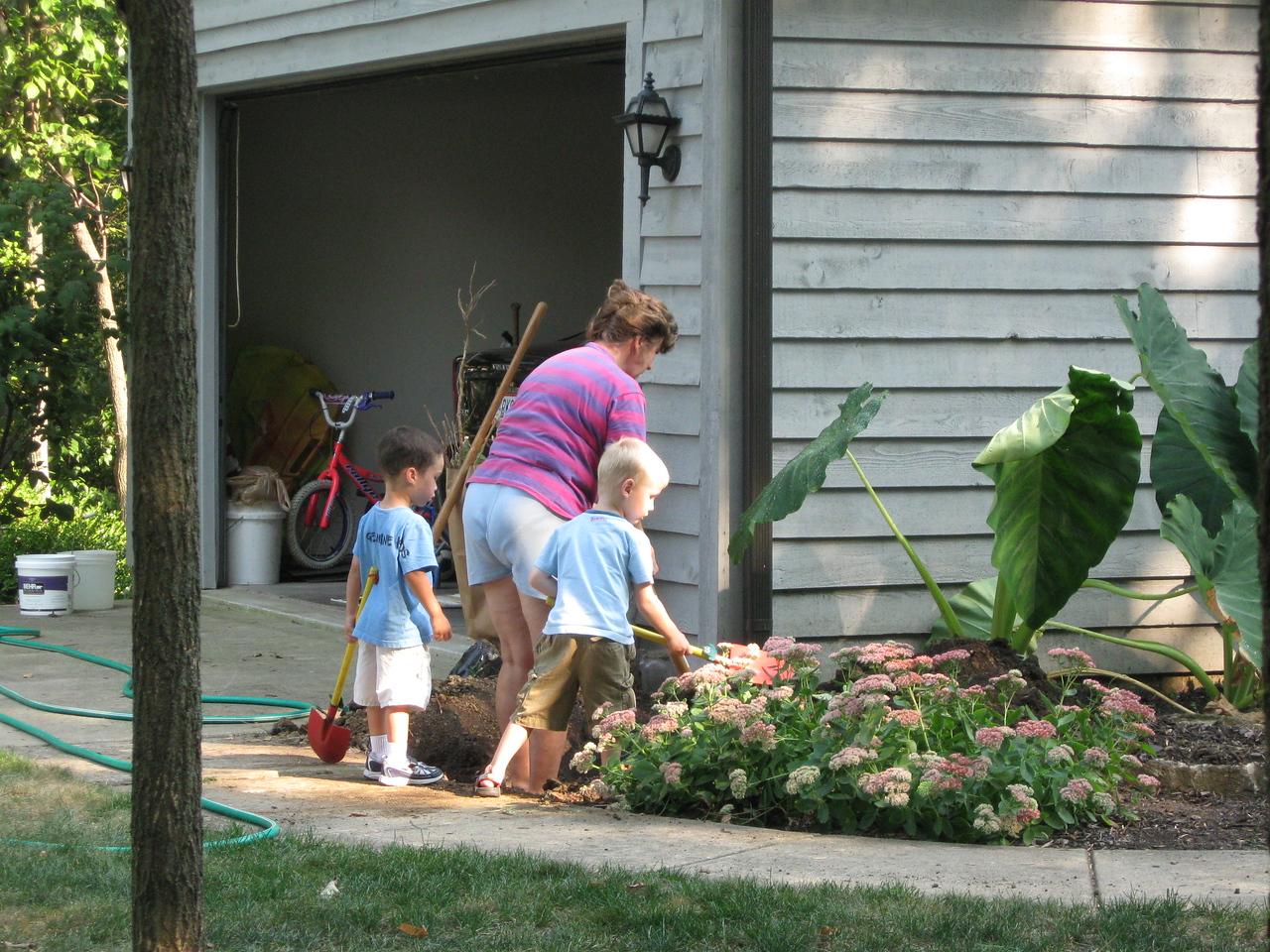 Kellen and Jackson helping Miss Juanita dig