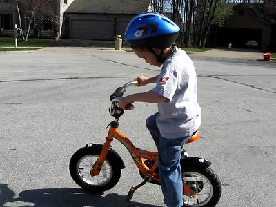 Kellen riding a two wheeler!