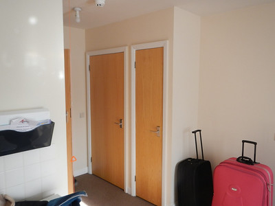 Another photo showing the wardrobes.
