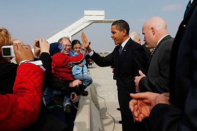 President Barack Obama greets visitors upon his arrival in Columbus, Ohio, Friday, March 6, 2009. (AP Photo/Gerald Herbert)