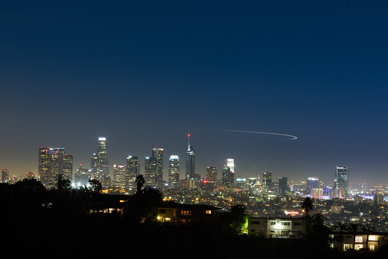 """An aircraft flying around the city did a great job """"lightpainting"""" in the sky for me.<br /> <br /> #Photography #NightSky #SkyLine #LosAngeles #L.A. #L.A.Lights #OCPhotog #NightPhotos"""