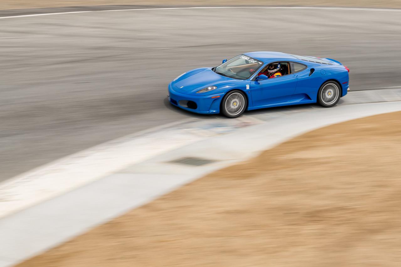 Ferrari F430 exiting T8 over the new curbing