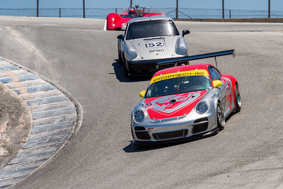 2010 Porsche GT3 Cup car of William Ward drops down the Corkscrew
