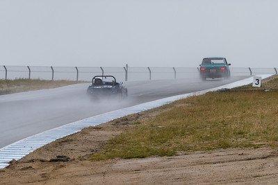 Datsuns braking for Turn 6 in the rain