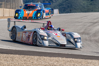 Audi R8 LMP leading Riley Scott Mark XI into the Corkscrew