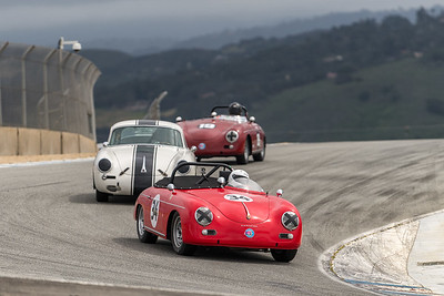 A trio of Porsche 356s drops into the Corkscrew