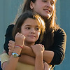 2006.  Sisters at a Gig Harbor Summer Concert.  They just looked so naturally loving I couldn't resist.
