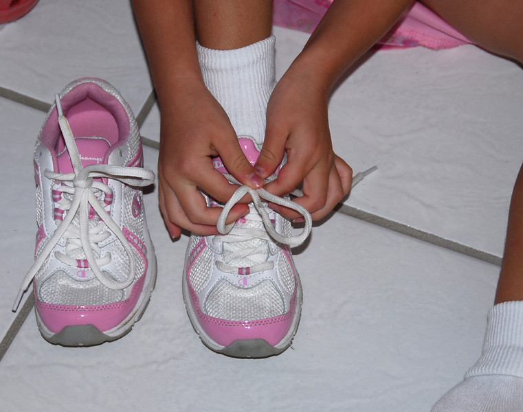 Mela can tie her own shoes...
