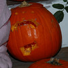 Mela carved her pumpkin all by herself.  She is very proud of the results.