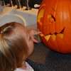 Vanessa is telling Mommy that this pumpkin needs more light.