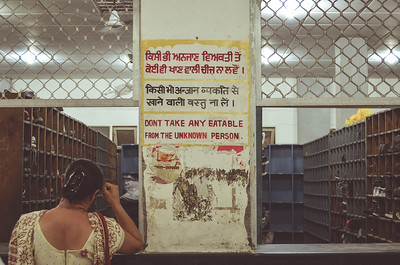 Do not take eatable from strangers. You'll see the same sign in some trains in India.