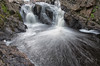 Christine Falls. GPS Coordinates: ( 43.5128021, -74.3085344 ) The falls are located slightly downstream from the power generation dam on the Sacandaga River. There are 2 small waterfalls, dropping approximately 20 feet to a wonderful local swimming hole.