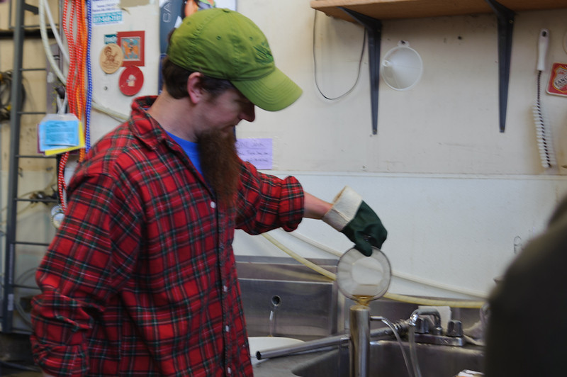 Kevin sets up one of the many hydrometer readings taken during the brew day.