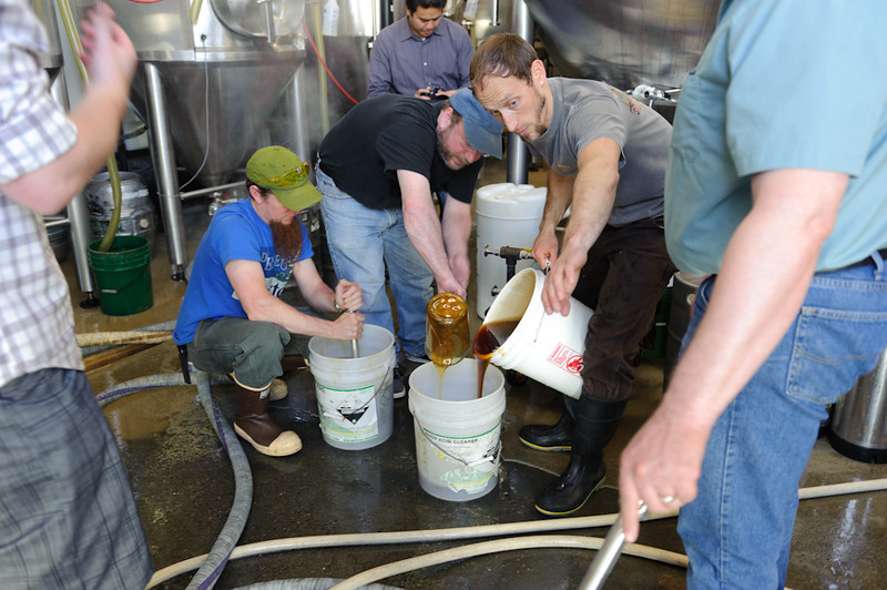 James and Kevin get the crew working on the honey. Wildflower and Blackberry. Decliciously sticky!