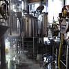 The brew house. The brew deck has the mash tun, boil kettle, and whirlpool kettle. All have spray balls, stirring paddles, and a bottom trap door for easy cleaning.