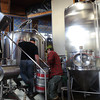 Kevin and helper haul one of several kegs of fresh pressed cider to add to the whirlpool.