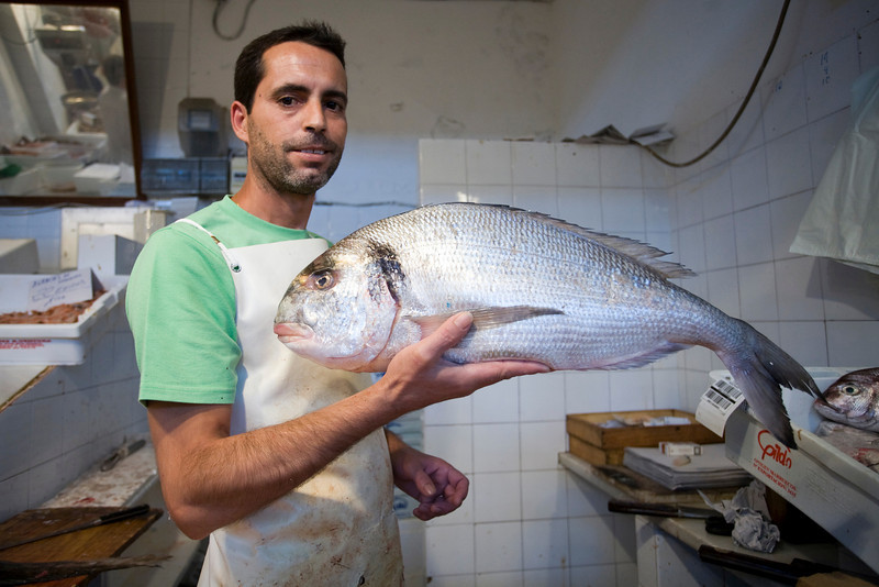 Fishmonger proud of his goods, Sanlucar de Barrameda, Spain