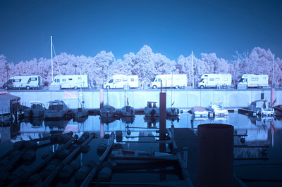 Campers by the Guadalquivir river in Gelves Marina (Seville, Spain). Infrared image, red and blue channels were changed in the edition process.