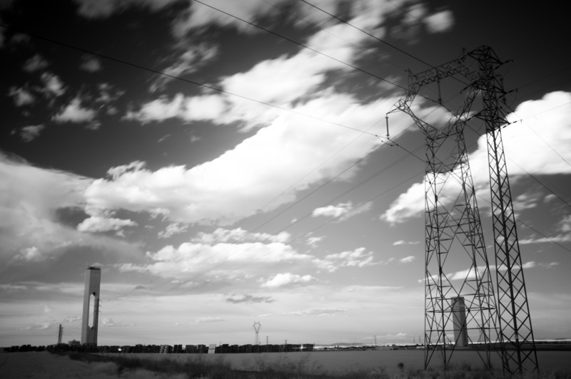 Infrared image of solar plant towers and power lines, Sanlucar la Mayor, Seville, Spain
