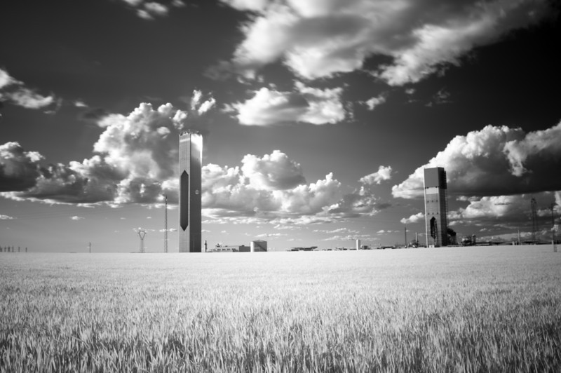 Infrared image of solar plant towers in a wheat field, Sanlucar la Mayor, Seville, Spain