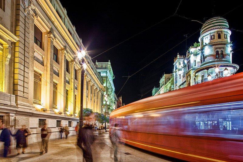 Streetcar at night on Constitution Avenue, Seville, Spain