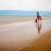 Kids on the beach, long exposure shot.