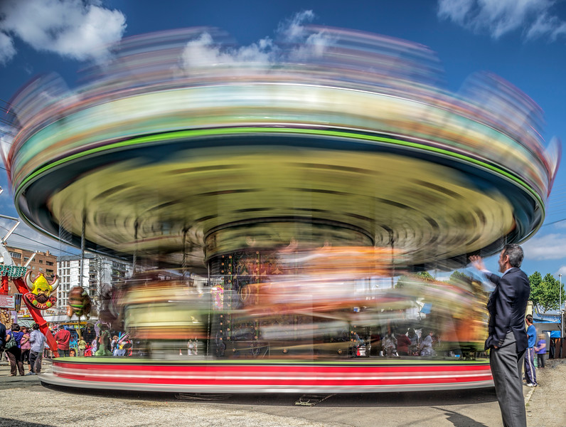 Carousel in a funfair, Feria de Abril, Seville, Spain. Long exposure shot.