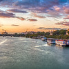 Panoramic view of the Guadalquivir River at dusk from San Telmo Bridge,  Seville, Spain