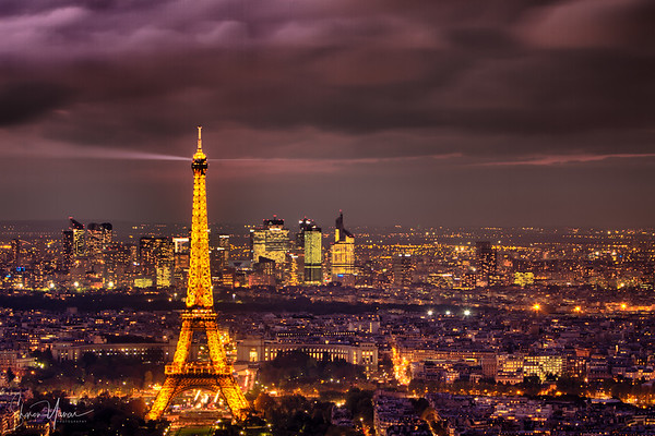 View of the city of Paris at night with the Eiffel tower