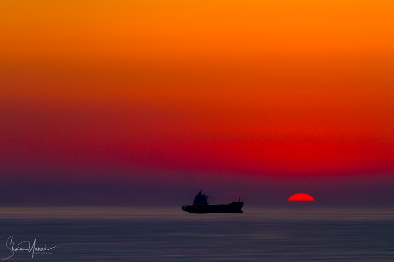 Ship at the sea on sunset